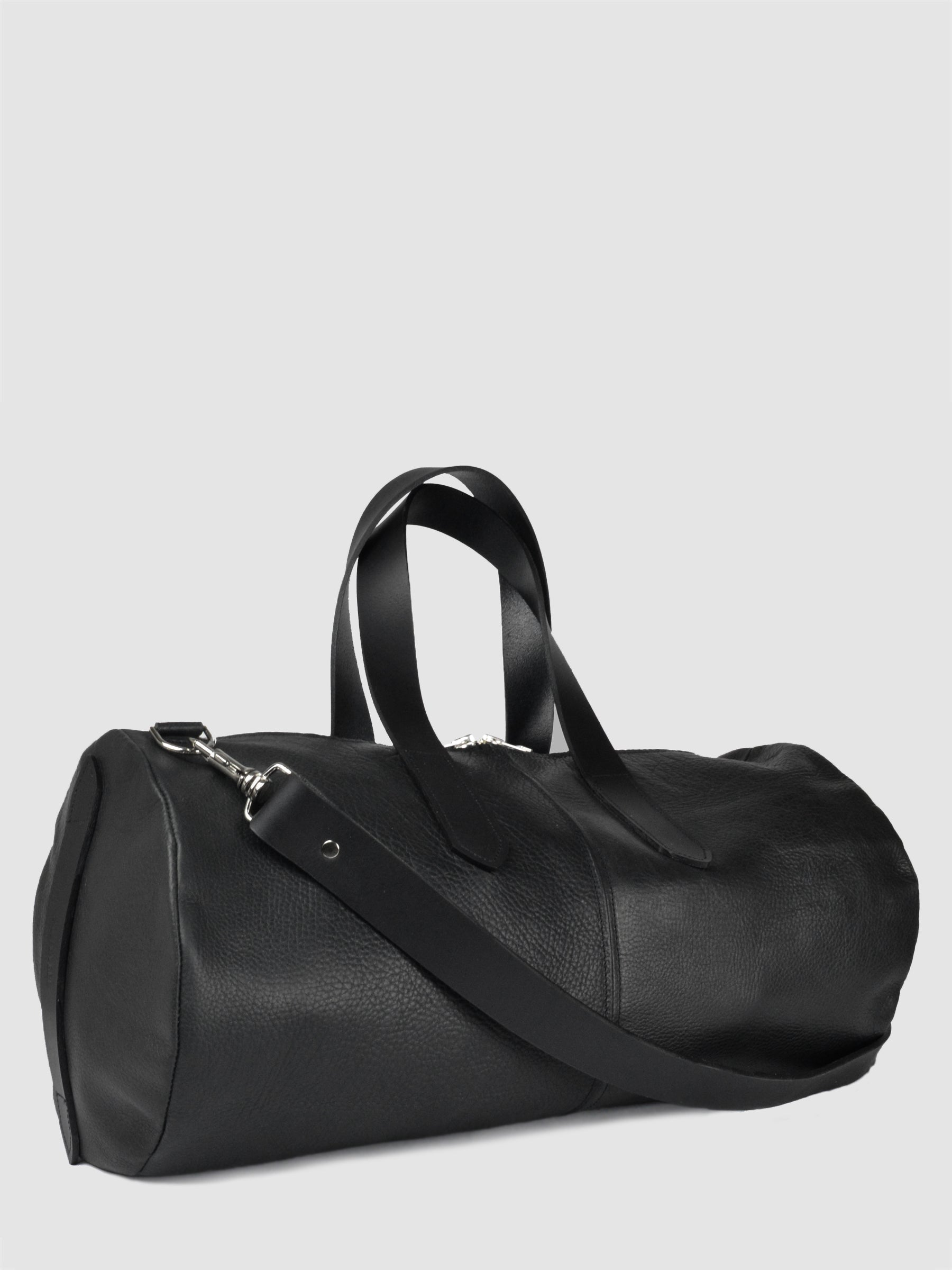 "SONYA LEE Named after our designer's brother. The Douglas duffle features; a side zipper pocket for accessible storage, large top zipper, two twin leather handles, side handle, and extra thick crossbody/shoulder strap. Made from our classic Canadian bison hide. Size: 21"" x 11"" x 11"". Made in Canada."