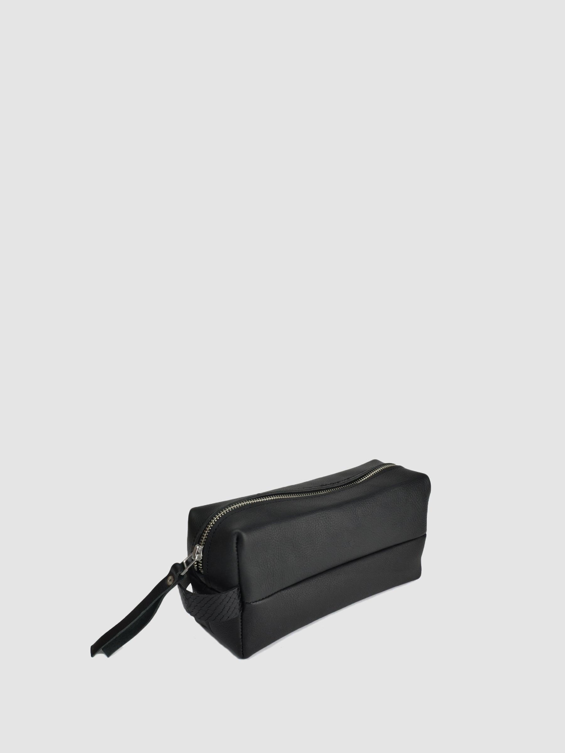 SONYA LEE. The dopp kit is named after Charles Doppelt a 20th century leather craftsman whos company designed the first leather toiletry bag in 1926. It features a side handle and zipper closure. Made with our classic Canadian bison hide. 10% of proceeds will go toward the Nature Conservancy Canada.