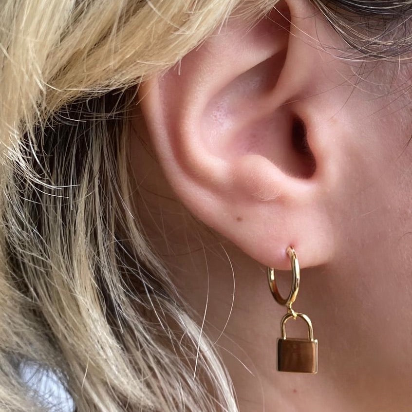 """locked"" dangler earrings"