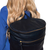 Back  view.  Gray backpack. Genuine leather. Girl carrying  backpack on back using shoulder straps.