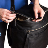 Black leather backpack top zipper use demonstration.