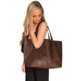 Dark brown leather. Braided dark brown leather strip with matching leather tassel.  Over the shoulder. Roomy.