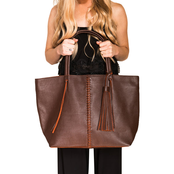Dark brown leather. Braided dark brown leather strip with matching  leather tassel. Roomy.