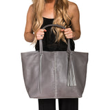 Gray leather. Braided gray leather strip with matching leather tassel. Roomy.
