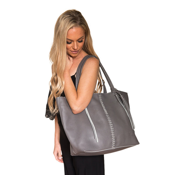 Gray leather. Braided gray leather strip with matching leather tassel. Roomy. Over the shoulder.