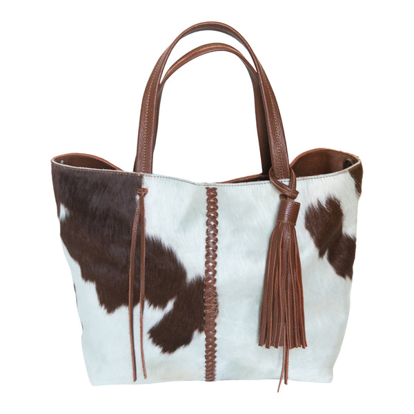 Brown and white cowhide.  Braided brown leather strip.  Brown handles.  Removable brown leather tassel.