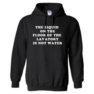 """The Liquid On The Floor Of The Lavatory Is Not Water"" Tee - UNISEX"
