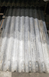 Corrugated Sheets of Tin