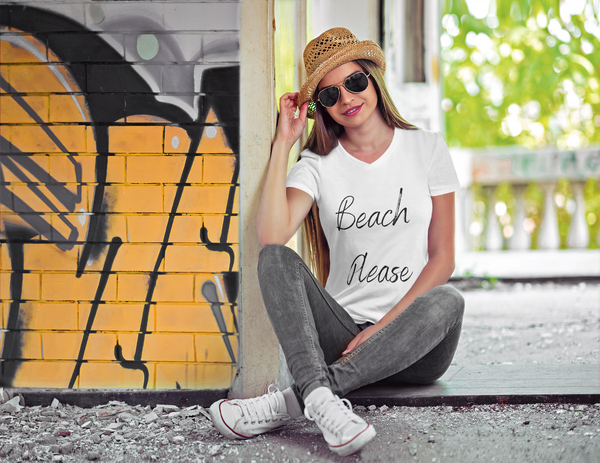 Woman sittiing in doorway wearing 'Beach Please' v-neck tshirt