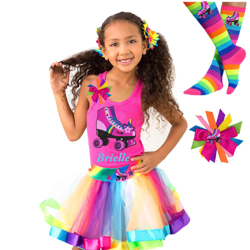 Girl wearing pink tank top shirt with personalized name and pink unicorn roller skate, Rainbow tutu skirt with stars and roller skate, rainbow knee socks with roller skates, and birthday roller skate hair bow
