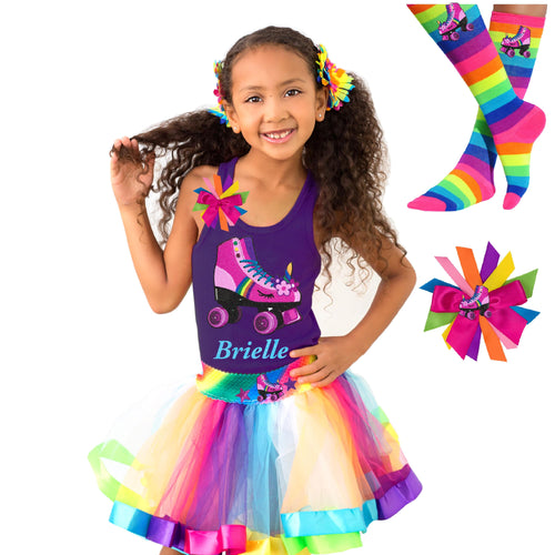 Girl wearing purple tank top shirt with personalized name and pink unicorn roller skate, Rainbow tutu skirt with stars and roller skate, rainbow knee socks with roller skates, and birthday roller skate hair bow