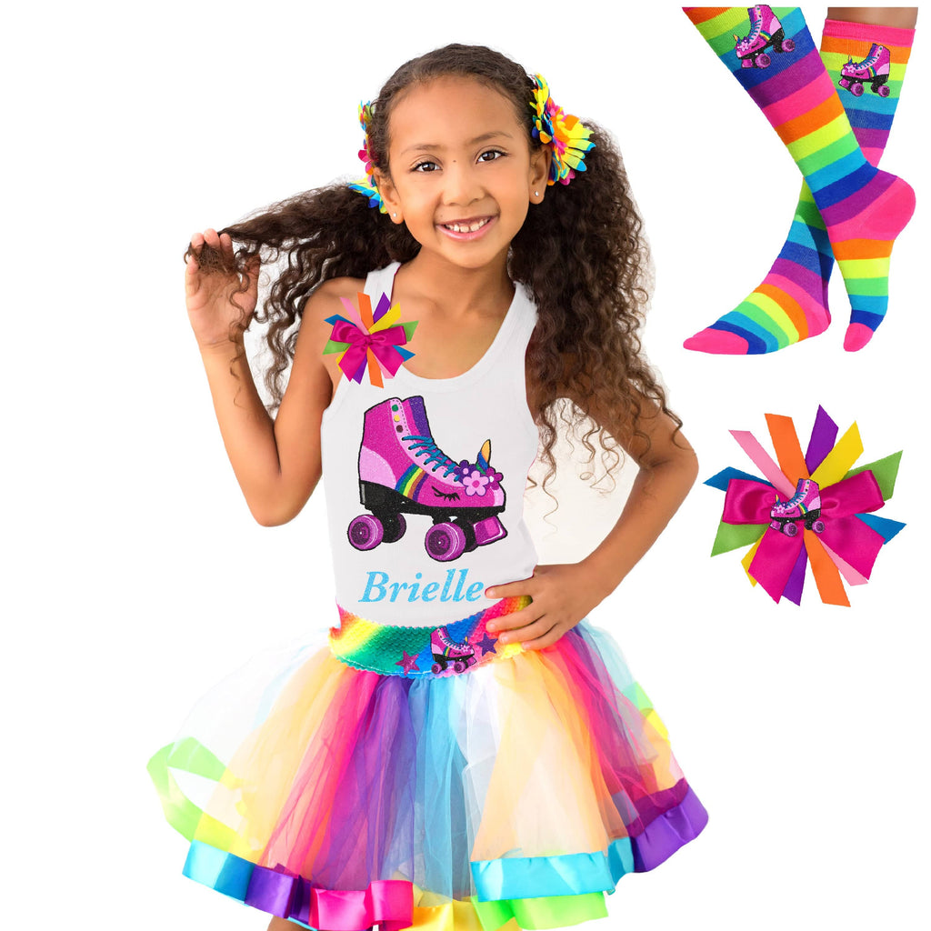 Girl wearing white tank top shirt with personalized name and pink unicorn roller skate, Rainbow tutu skirt with stars and roller skate, rainbow knee socks with roller skates, and birthday roller skate hair bow