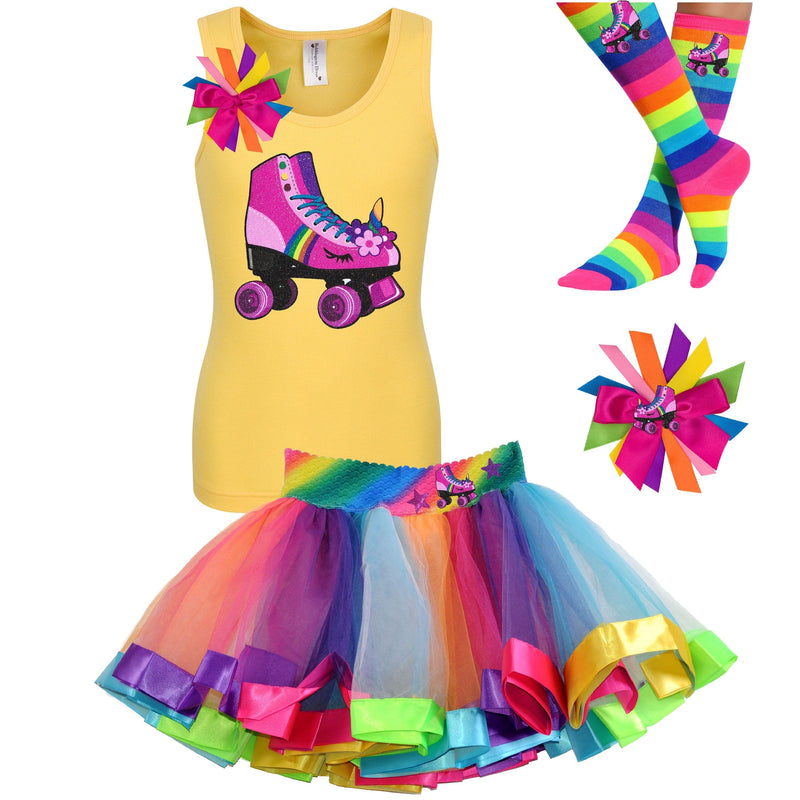 Girl wearing yellow tank top shirt with pink unicorn roller skate, Rainbow tutu skirt with stars and roller skate, rainbow knee socks with roller skates, and birthday roller skate hair bow