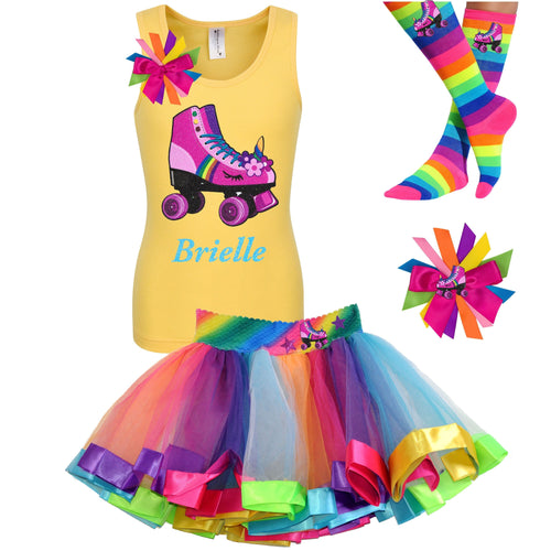 Yellow tank top shirt with personalized name and pink unicorn roller skate, Rainbow tutu skirt with stars and roller skate, rainbow knee socks with roller skates, and birthday roller skate hair bow