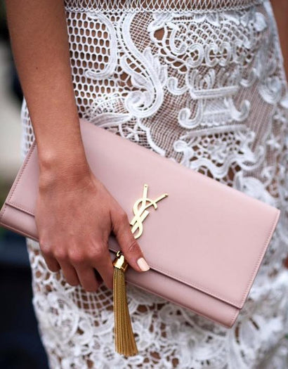 9069927d8b47 More from Saint Laurent. Saint Laurent. Blush Pink Tassel Clutch. Rent for   99