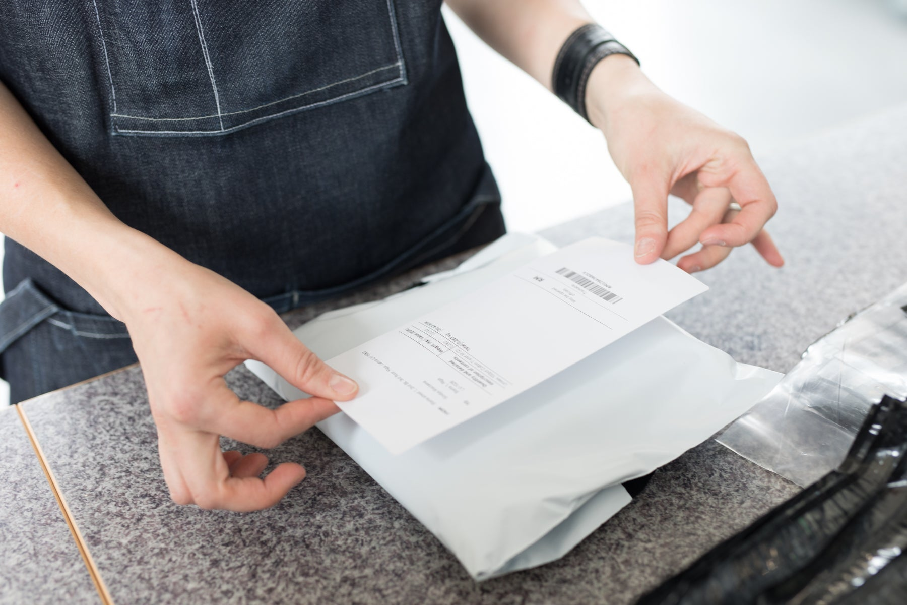 Image of man putting shipping label on package