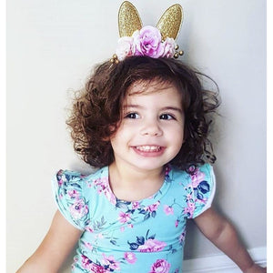 Gold glitter floral bunny ears.