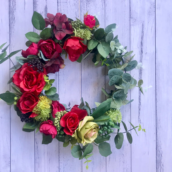 Christmas floral wreath - reds/burgundy.