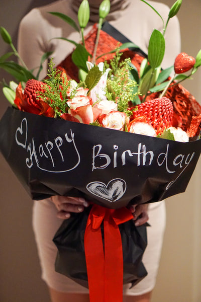 Red Roses bouquet in black wrapping