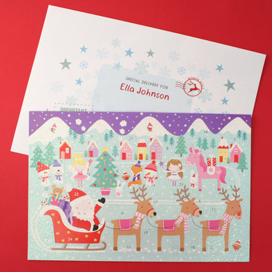 Unicorn and santa advent calendar with personalised envelope
