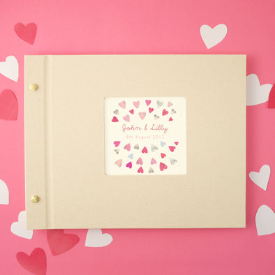 Personalised photo album with love heart designs