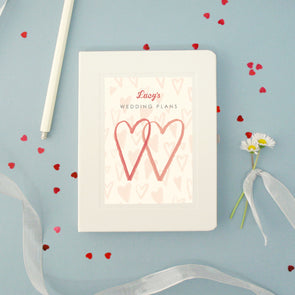 A hardback notebook for wedding plans with personalised text