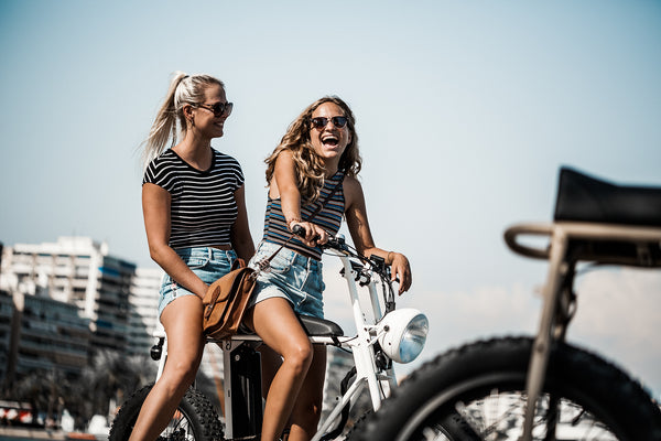 Girls on UNIMOKE electric bike on Mallorca