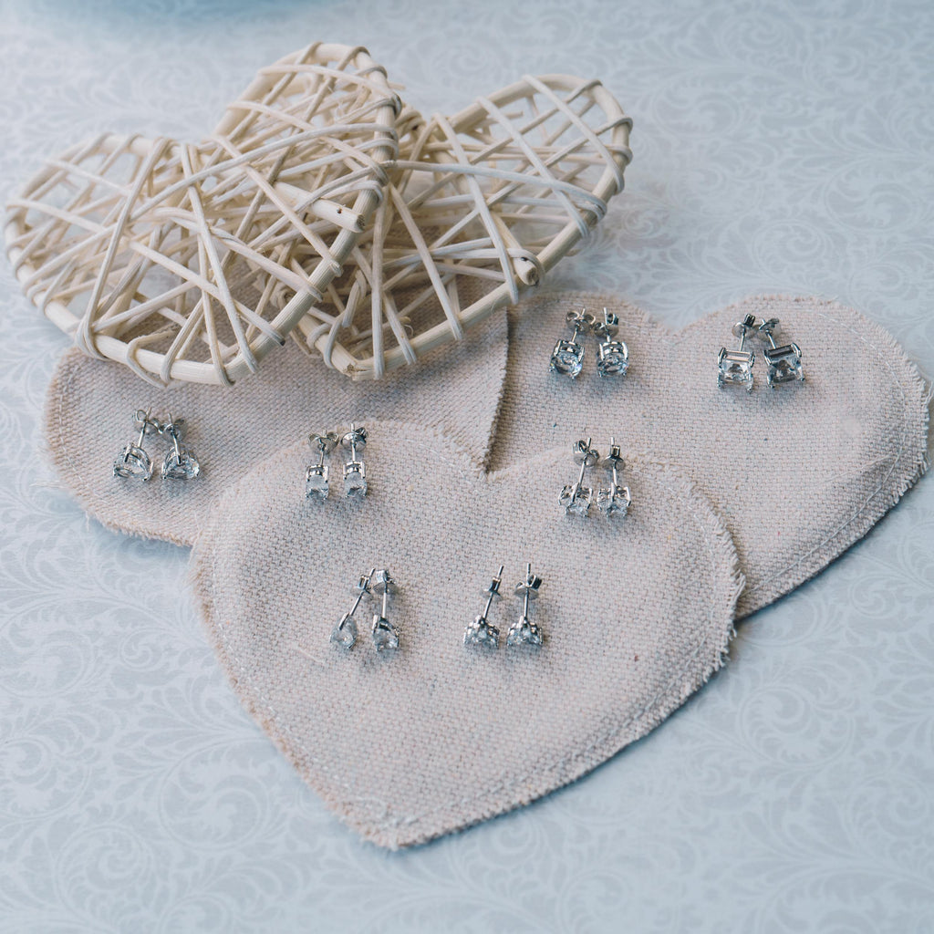 Seven Pairs of Earrings Created with Swarovski® Crystals