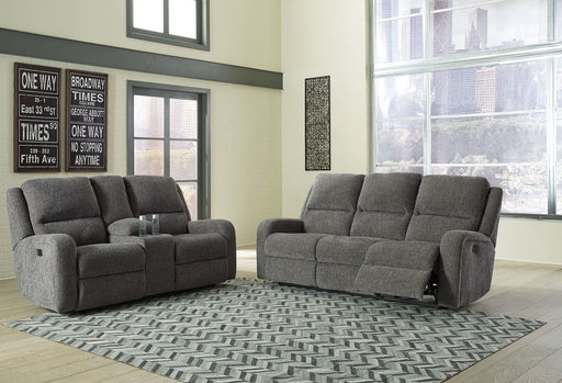 Krismen Charcoal Power Reclining Sofa and Loveseat with Adjustable Headrests