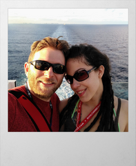 Billy & Larissa from CruiseHabit on Stern of Empress of the Seas