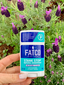 Image of FATCO Stank Stop natural deodorant, lavender & sage, in front of a lavender plant.