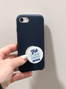 FATCO Fat is Your Friend Pop Socket phone holder and stand attached onto a mobile cell phone