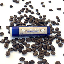 image showing the FATCO Fat Stick vanilla and coffee surrounded by coffee beans