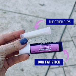 FATCO Fat Stick placed near a standard 0.15 oz lip balm tube showing how much larger our Fat Stick is