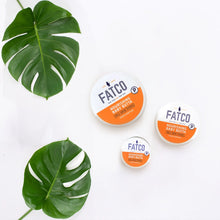 three varying sizes of Jars of fatco Baby Butta paleo tallow balm lotion, surrounded by monstera leaves against a white background