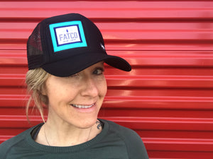woman wearing a FATCO big truck ball cap hat