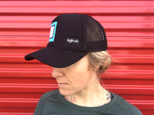 woman wearing a FATCO big truck ball cap hat front angled view