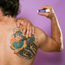 image showing a man applying the fatco fat stick to a large tattoo in his back