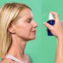 woman blonde woman applyies FATCO Toner to her face skin against a green background