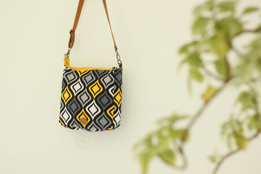 Swirls in Black & Yellow  Sling Bag