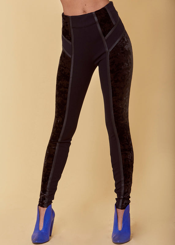 Crushed velvet legging style pant with mid-rise, pull on styling, Cuba piping detail and ponte self-fabric paneled side accents in black.