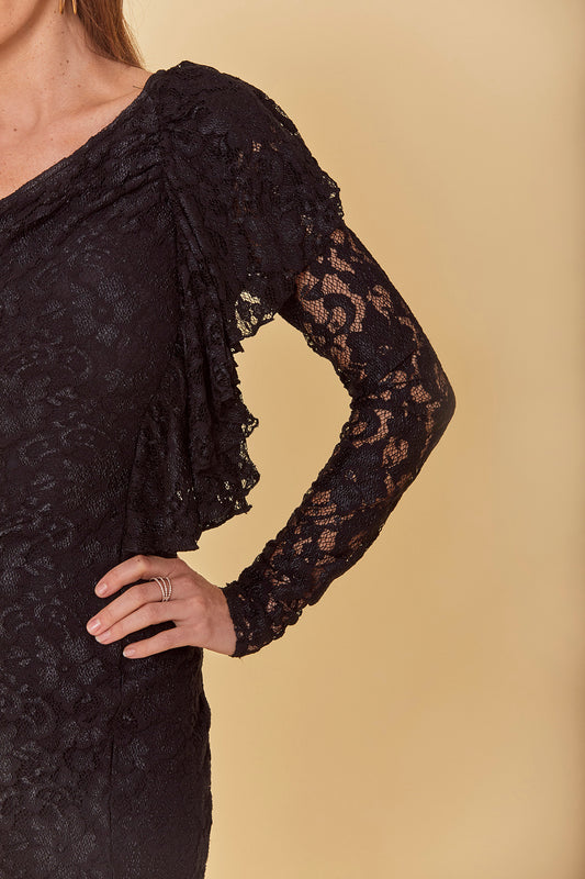 Fitted mini dress with knit body and lace overlay, one shoulder design and front ruffle accent in black.