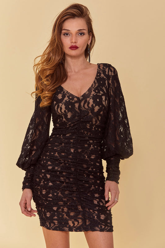 Lace fitted mini dress with long, oversized Victorian sleeves, V-neck and all over ruching with lacy black overlay and nude knit body.