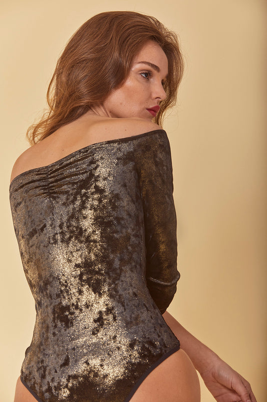 Crushed velvet bodysuit featuring a one piece design with thong bottom, off-the-shoulder fit, midi sleeves, front ruching and gold foil detail in black