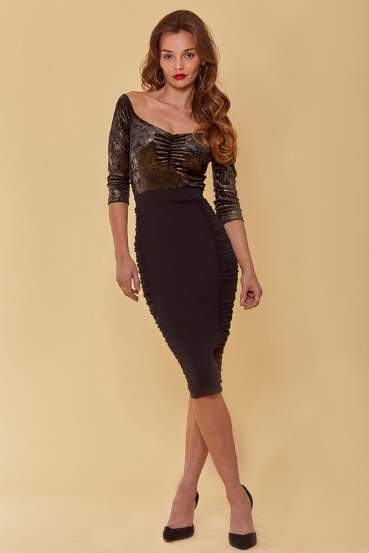 Jersey bodycon midi skirt with high-rise fit and side panel ruching in black.