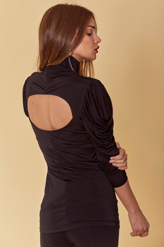 Jersey statement top with fitted, hip length design, ruched mock neck, long draped sleeves and open back cutout in black.
