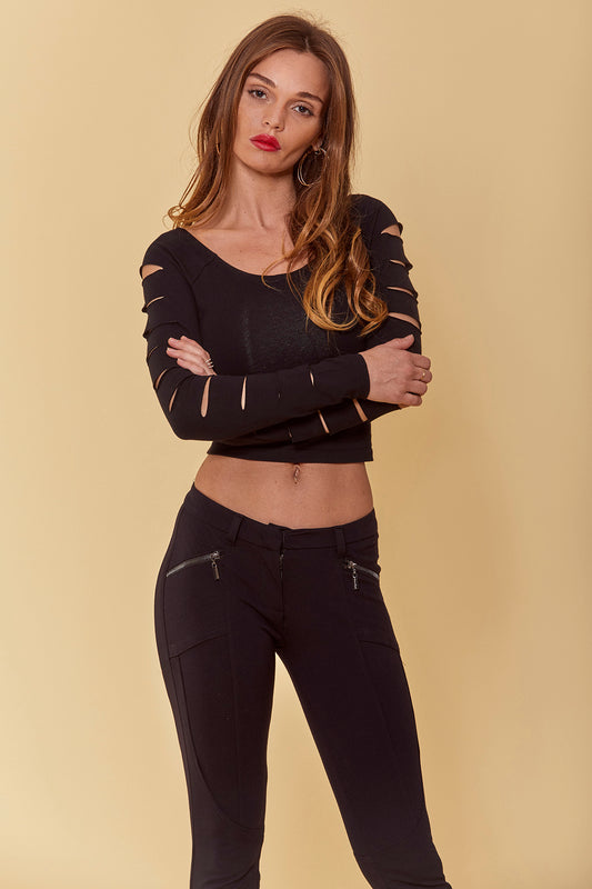 A fitted spandex top with cropped design and bodycon fit, long sleeves with cutout slits and boatneck in black.