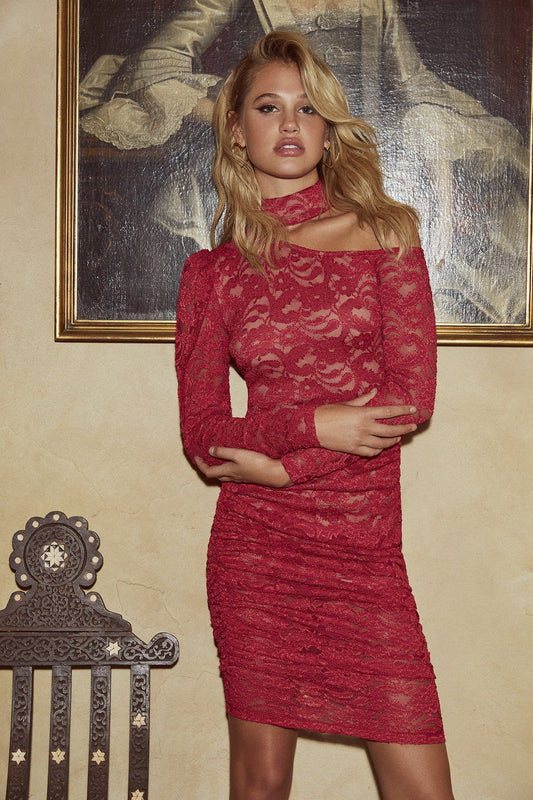 Lace one-shoulder bodycon mini dress with mock neck in red.