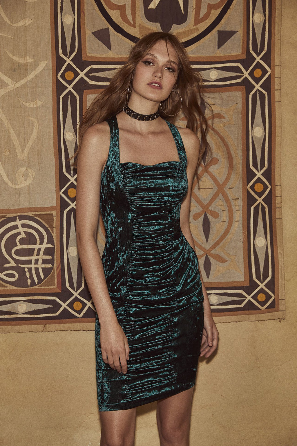 Crushed velvet sleveless bodycon midi dress with front ruching from bodice to hem and wide straps with cross back in dark, Storm Green.