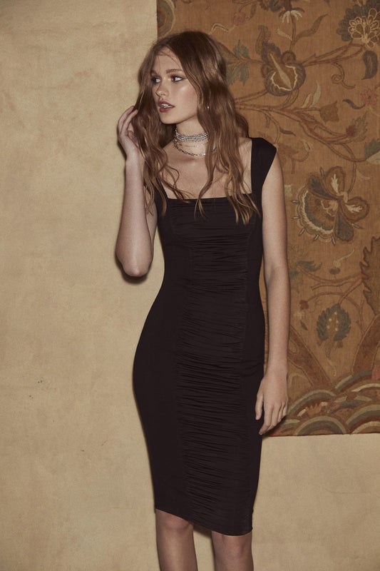 Jersey sleveless bodycon midi dress with front ruching from bodice to hem and wide straps with cross back in black.